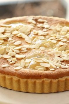 A delicious Pear Almond Tart Recipe perfect for Thanksgiving! A buttery pastry combines with a rich almond filling and tender pears for one showstopper of a dessert! Pear Dessert Recipes, Great Desserts, Köstliche Desserts, Delicious Desserts, Cake Recipes, Plated Desserts, Desserts With Pears, Recipes For Pears, Soup Recipes