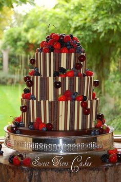Chocolate and berries wedding cake