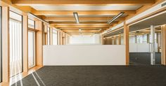 BauBuche was used both for the visible beams and for the floor element of the new euregon AG building, featuring a timber skeleton design. Beams, Divider, Stairs, Flooring, Building, Interior, Room, Furniture, Design