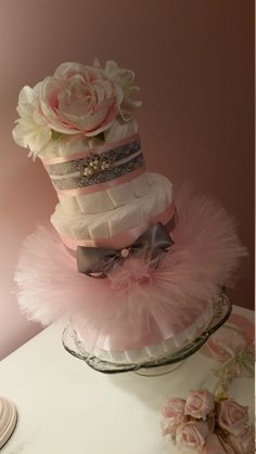 This cake came out gorgeous! You will receive:  - 65 diapers with a 3 tier cake in Size 2 Pampers Swaddlers or Size 3 Babyganics Organics to achieve similar dimensions, the larger size is more expensive to make and highly desirable for a recipient so it can display longer without having to dismantle to use right away. -1 Tiara Stretch Headband for Baby 15 inches around -1 Hand tied Tutu Photo Prop for Newborn (All Pink tulle is illustrated in photos.) Your cake will arrive wrapped in bubble…