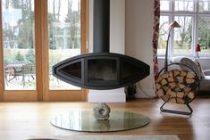Eyefire Suspended Wood Burner by FiremakerStoves on Etsy Floating Fireplace, Stove Fireplace, Fireplace Ideas, Log Burner, Ceiling Height, Centre Pieces, Foyer, Living Spaces, Sweet Home