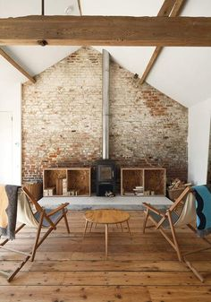 love that brick wall and old fireplace