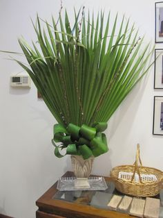 Palm Sunday.....I love this arrangement. Ti leaves with the palm fans.