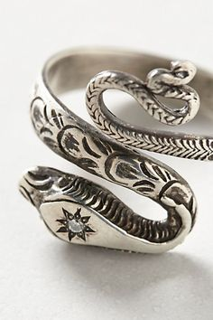 Diamondback Ring #anthropologie Would really like this in gold.