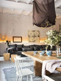 There isn't anything about this Barcelona flat that I'm not absolutely obsessed with. The whitewashed herringbone floors, the black trimmed windows, the vaulted ceilings, the exposed brick, the old world fireplace, the free standing bathtub in the bedroom, the oversized lanterns and the super long