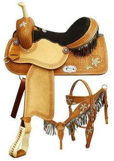 Double T saddle. This saddle features square basket weave and painted floral tooling. Rough out fenders and jockeys with a black suede seat. Rawhide braided horn and a metallic fringe li Horse Gear, My Horse, Horses, Dark Horse, Horse Riding, Western Horse Tack, Western Riding, Western Saddles, Stirrup Leathers