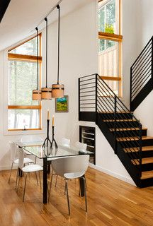 modern black stairs, open concept home, dinning room