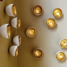 {Faux Seed Wall Décor in Gold Leaf} made of a resin material