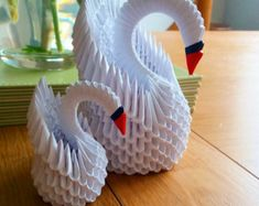 This origami swan (standard sized) is just one of the custom, handmade pieces you'll find in our centerpieces shops. A selection of different origami swans. Vary slightly in price depending on your preference of size, model or colour. Perfect as a gift or Instruções Origami, Design Origami, Origami Ball, Origami Butterfly, Paper Crafts Origami, Paper Crafting, Origami Tattoo, Kirigami, 3d Origami Schwan