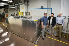 David Dean, Alfredo Galindo-Uribarri and Chris Bryan of Oak Ridge National Laboratory check on a prototype detector at the High Flux Isotope Reactor, a Department of Energy