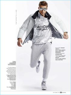 Sporty style is front and center with Mikus Lasmanis donning a Nautica down jacket and Adidas pullover. Fernando Carrillo outfits Mikus in GUESS joggers and Adidas sneakers as well.