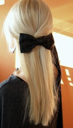 Like the twisted hair with a bow to hold in place