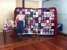 Tara from the Shoreditch Sisters WI with the Embroideries anti- femal gential mutilation quilt. Each square is a vulva made by a different woman. The campaign is to raise awareness of this barbaric practice.