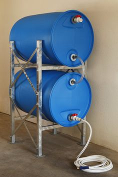Mark - build a stand like this! Titan Ready Water Hydrant Water Storage System with Barrels - General Purpose Storage Rack Hardware - Rain Barrel Stand, Rain Barrel System, Water Barrel Storage, Reclaimed Water, Storing Water, Water Catchment, Tank Stand, Shed To Tiny House, Water Collection