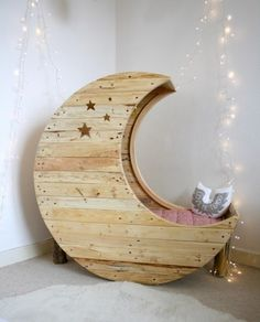 Wooden, moon shaped bed. Good night and moon dreams.