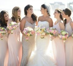 blush and champagne bridesmaid dresses accented with blush, ivory, and pale peach bouquets // Floral Sentiments // The Studio Photographers