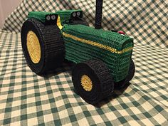 This is a pattern for a crocheted tractor sculpture. It is worked in pieces and stiffened over easy to find objects. There are many photos included in the pattern to help with the construction of this little tractor. An advanced beginner could easily make this design. It uses basic crochet techniques.