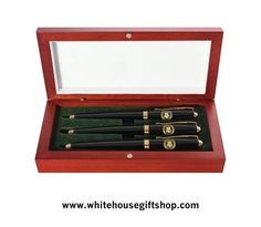 "The White House Black Lacquer Roller Ball Presidential Pen Set of Three, Custom Rosewood Case, 22KT Gold Finished Accents, Two Piece Construction, Sleek Profile, Smooth Flow, Refills Available in Pen Department. Enter Promo Code ""PIN"" for 10% off your entire order!"