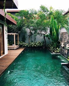 I like the idea of a house being on the edge of a body of water, insated of HOUSE--SPACE--POOL,   this gives more of a seamless apperaance,   similar to pools that are partially inside the home also