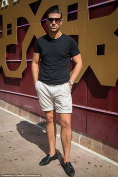 Suave: Jon Clarke looked dapper in beige shorts, loafers and a black T-shirt