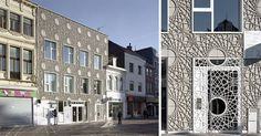 This building facade is covered in decorative panels made from concrete