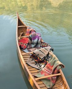 antique wooden canoe and colorful indian blankets