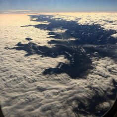 Im so lucky to be able to see our #beautiful #world from above  it's one of my favorite things about #travelling #stunning #viewfromthetop of the #rockymountains in #winter and this #whitefluff #carpet of #clouds  #beautifulEarth #eyeranititravel #lifeonanairplane #alwayswindowseat #upandaway #travel #overcanada