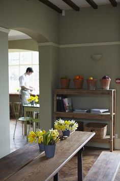 Cafe interior design - love the idea of flowers as a centre piece, maybe a single flower in a small vase?