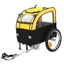 Do you love going on long bike rides, but your dog finds it hard to keep up? Then the cheery yellow Mini Bee dog bike trailer is perfect solution. When your dog gets tired it can rest inside the trailer while you carry on with your excursion. Dog Bike Carrier, Airline Pet Carrier, Dog Bike Trailer, Dog Bike Basket, Biking With Dog, Cavachon Puppies, Pet Stroller, Dog Cages, Pets