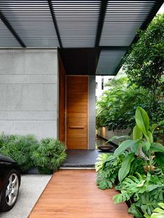 Minimalist House // modern wood door / walkway at the entry way / 66MRN-House by ONG&ONG » CONTEMPORIST