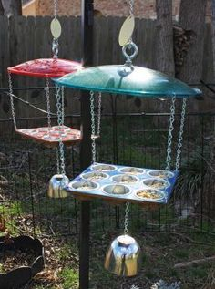 bird feeder made from cupcake tins, but I have no idea what is hanging from the bottom and why it's there.