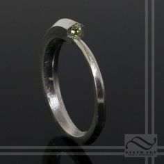 Ouroboros - Sterling Silver & Custom Gemstone.  The Ouroboros refers the the ancient symbol of a serpent eating its own tail. In this version, I have simplified the design down greatly and modernized it for a simple yet recognizable ring.