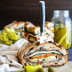 Picnicking, tailgating or feeding a small crowd? Healthy vegan or vegetarian Italian Pressed Sandwich is packed with bold flavors.