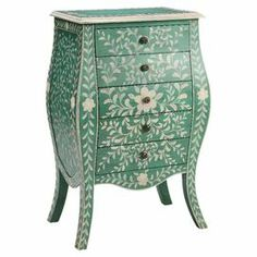 "With a bombe-style silhouette and 5 drawers, this hand-painted green and cream chest offers a touch of organic appeal to your decor. Use it as a console table behind your sofa or to stow table linens in the dining room.   Product: ChestConstruction Material: Engineered wood Color: Green and creamFeatures:  Five drawersHidden storageDimensions: 40"" H x 26"" W x 16"" D"