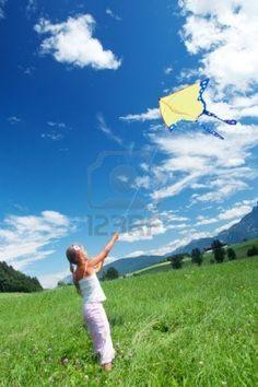 http://us.123rf.com/400wm/400/400/macsim/macsim1105/macsim110500081/9525273-child-flying-a-kite.jpg