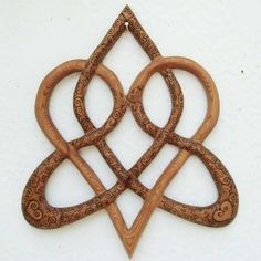 Wood Burned Stylized Celtic Heart-Knot of Everlasting Love-Triquetra MEANING: Stylized variation of the Knot of Everlasting Love. While wood burning a Celtic Heart onto a cross,