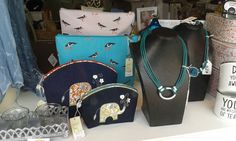 Elephant cosmetic bags, bird wash bags and some lovely costume jewellery in our window at Lorient Gift Dun Laoghaire