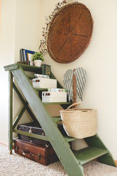 An old boat ladder is transformed into a hallway shelf with paint, and help from storage boxes and baskets.