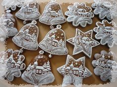 These intricately-iced gingerbread cookies look way too gorgeous to eat! They are for hanging on the tree, but of course totally edible. Gingerbread Man Cookies, Christmas Gingerbread House, Christmas Sugar Cookies, Holiday Cookies, Christmas Baking, Gingerbread Houses, Iced Cookies, Cupcake Cookies, Cupcakes