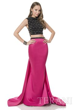 Two piece prom dress ensemble featuring heavily encrusted side tie bodice crop top. This prom gown is finished with a satin mermaid skirt and attached fishtail back.
