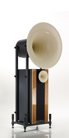 I like that this speaker as it is trying to use a classic effect with the mega phone part of it displaying an old fashioned design even though it's modern. I think the overall design is classy and effective. This gave me help when designing my speaker.