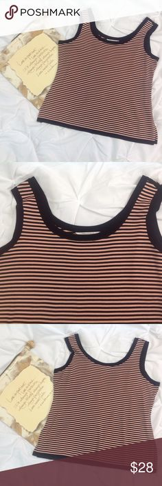 "Misook Pink Black Striped Knit Tank Top 1X Misook pink and black striped tank top. Size 1X. 100% acrylic. Warm water wash. Lying flat, approximate measurements are: bust 23""; waist 21.5; hip 24""; shoulder to hem 26""; 5.5"" slit on both sides. (E0323-039) Misook Tops Tank Tops"