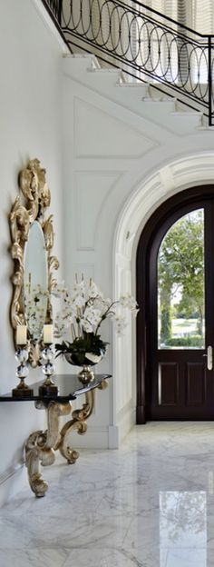 Christopher Guy Opera Mirror And Christopher Guy Chamonix Console Table ay Alchemy Fine Homes