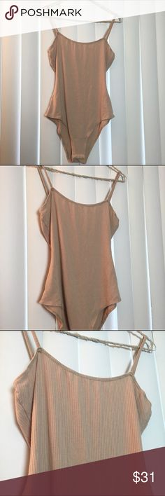 Stella nude ribbed bodysuit Perfect condition NWOT. Super versatile and comfortable. Tag size small, can also fit a medium. From Stella not Brandy Brandy Melville Tops Tank Tops