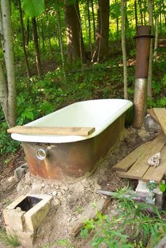 Could be used as idea for boiling down sap- with taps lines running right into the tub! Rocket stove bathtub thewaldeneffect.org