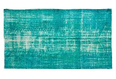 Teal overdyed Rug. Would look great with a white sofa
