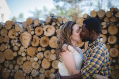 Engagement Photography Kiss wood pile
