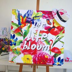 """""""let life bloom"""" design & artwork by (www.carolinerovithi.com) & @storymood (www.storymood.com) for Filia's baptism and her very creative and colorful parents @elenimicha & @galitsios! with custom made #panamahat for guests #gifts #bobonieres and all #decoration with #bright #intense #colors !! #art #artwork #flowers #floral #tropical #flamingo #frog #parrot #artist #baptism #concept #life #bloom @islandathensriviera"""