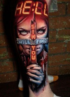 Horror tattoo, a woman holding a cross with the words Sin Will Find You & Hell in neon lighting, done on guy's leg. Weird Tattoos, Arm Tattoos For Guys, Trendy Tattoos, Sexy Tattoos, Unique Tattoos, Body Art Tattoos, Hand Tattoos, Wolf Girl Tattoos, Horror Tattoos