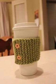http://moneysavingmom.com/2014/02/peek-recent-handwork-projects-cup-cozy-fingerless-gloves-embroidery.html